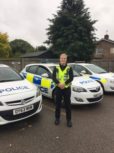Billie Scholten with police cars in Biggleswade
